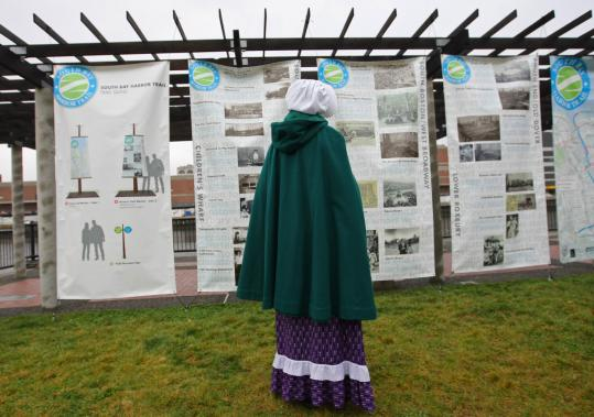 In period clothing, Sally Snowman, keeper of Boston Lighthouse, read the posted history of the channel. Construction on the South Bay Harbor Trail is scheduled to begin later this fall for completion in 2010.