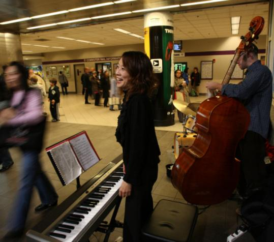 Musicians such as Mihoko Abe and Sean Farias performed Friday at North Station, as part of a new commuter program.