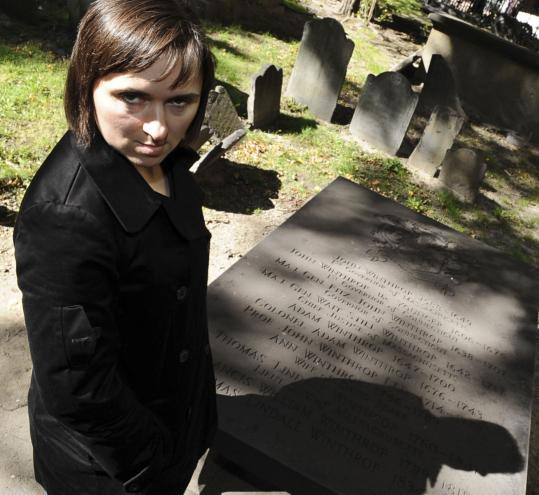 Sarah Vowell next to Massachusetts Governor John Winthrop's tomb in Boston.