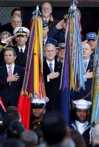 President Bush was surrounded by veterans yesterday at the rededication of the Intrepid Sea, Air and Space Museum.