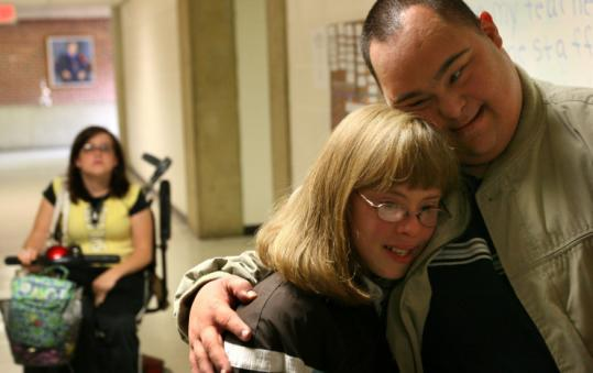 Jennifer Holden, 20, who learns independent living skills at George Mason University, got a hug from Vincent Roubin.