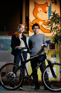 Christine Outram, leader of the Smart Biking Project at MIT, and Michael Lin, a graduate student at MIT's Media Lab, with the hybrid GreenWheel.