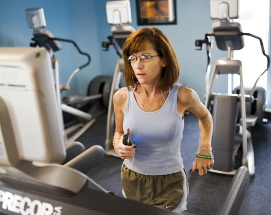 Mary Sontz, 42, of Portland, Maine, worked out at a gym in Westbrook, Maine, recently. She said likes the data aspects of PatientsLikeMe.com. Sontz was diagnosed with Parkinson's disease two years ago.