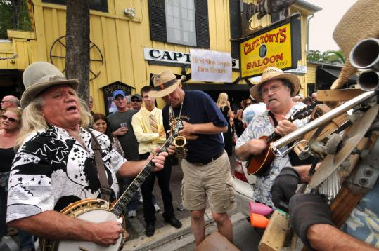 Musicians celebrated the life of Anthony Tarracino, known to one and all as Captain Tony, in front of Captain Tony's Saloon Saturday in Key West. The legendary former bar owner served as mayor from 1989 to 1991. He joined the stage with Jimmy Buffett (right) in 2005.