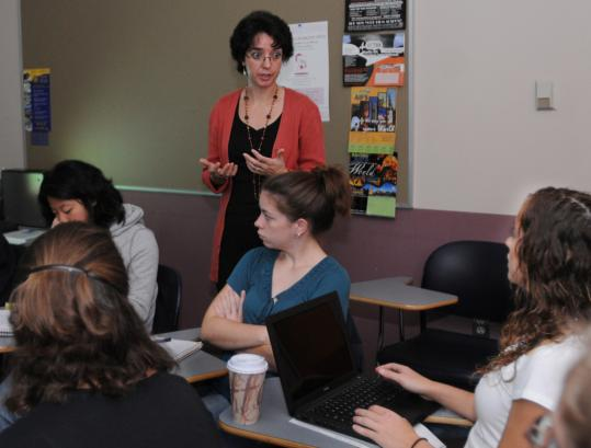 Professor Estrella Cibreiro taught a freshman seminar at the College of the Holy Cross in Worcester. ''This is the only class I have where I know everyone's name,'' said Sofia Spanos (with laptop, at right).