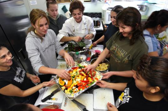 Kimberly Maloomian (center) teaches a class in Marlborough how to prepare low-cost ingredients such as roasted vegetables.