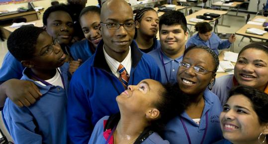 Students look up to Joshua Alexander, who teaches 7th and 8th grade at Lilla G. Frederick Pilot Middle School in Dorchester. The school has recruited males and has 23 men on its faculty of 55.