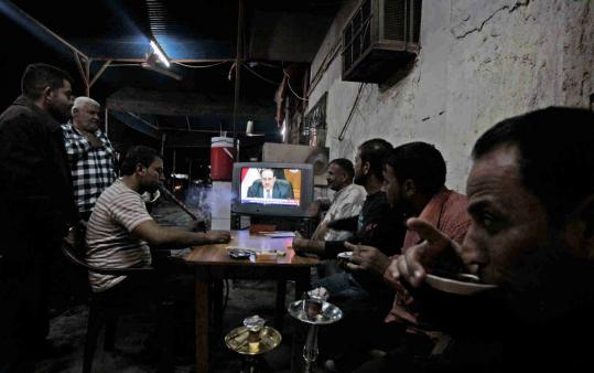 Iraqis gathered at a cafe in central Baghdad yesterday to watch Prime Minister Nouri al-Maliki's televised address. ''I assure you that there are no secret clauses or annexes in the agreement, nor permanent military bases in Iraq,'' he said.