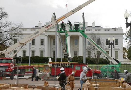 Jason Reed/REUTERSBUILDUP - Construction continued yesterday on the reviewing stand from which President-elect Barack Obama and other dignitaries will view his inauguration parade Jan. 20. Capitol Hill is also gearing up for a new session.