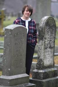 Marian Pierre-Louis visits the gravesite of the Hiram Cowell family, original owners of an 1835 house in Wrentham that she researched.
