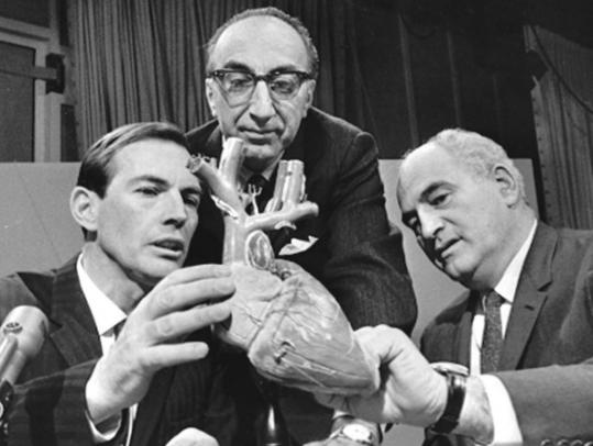 Three titans of heart surgery (from left), Christiaan Barnard of South Africa, Michael DeBakey of Houston, and Adrian Kantrowitz, conferred on the set of the CBS program ''Face the Nation.''