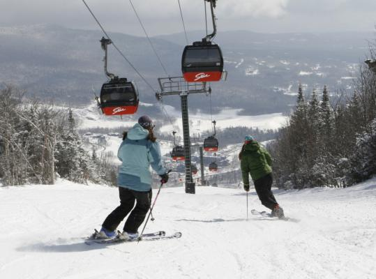 Enthusiasts enjoy a run down Stowe's Gondolier trail on Mount Mansfield.