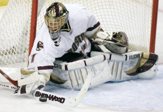 Cory Schneider in action at Boston College (above), and shortly after he was drafted by Vancouver (below).