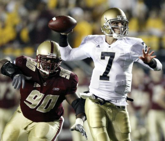 BC's B.J. Raji, hounding Notre Dame's Jimmy Clausen, could be a middle first-round draft pick.