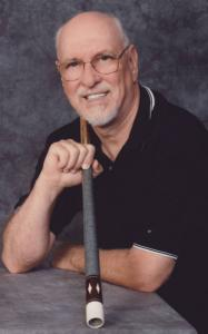 Tom McGonagle of Billerica, a champion pool player, has written a novel about a young pool player who searches for his biological father.