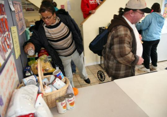 Patrons at the Bootstraps Food Pantry in Beverly.