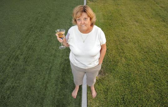 MARK J. TERRILL/ASSOCIATED PRESSCookie Smith of Garden Grove, Calif., replaced her lawn (left) with artificial turf to conserve water, but later learned that doing so had violated a city ordinance that bans artificial grass.