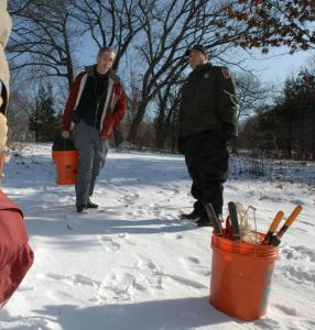 Volunteers prepare to clear saplings and invasive brush at Middlesex Fells Reservation last winter.