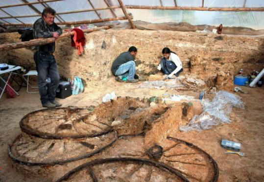 Archeologists worked yesterday near an 1,800-year-old bronze chariot discovered near the village of Karanovo, Bulgaria.