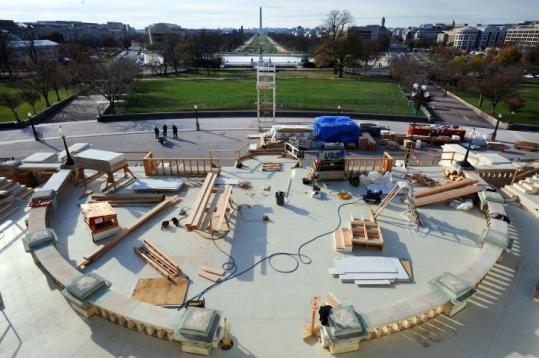 Construction of the inaugural dais proceeded this week on the West Front of the US Capitol. Turnout for the inauguration could easily eclipse a 1965 record of 1.2 million, officials said.