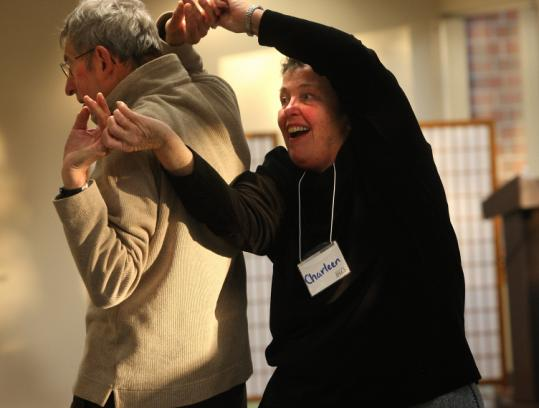 Charleen Alper (right) danced with her husband, Paul, at a class customized for people with Parkinson's disease.