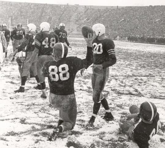 Ted Kennedy raised the ball in triumph after hauling in a touchdown pass in The Game of 1955, a 21-7 Harvard loss.