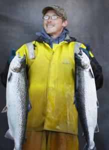 Erik Bagley of Cooke Aquaculture Inc., a Canadian company, with salmon harvested from a pen near Eastport, Maine.