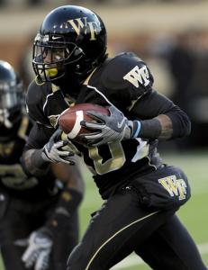 Kevin Patterson takes off with a BC fumble, one of two turnovers Wake Forest turned into touchdowns.