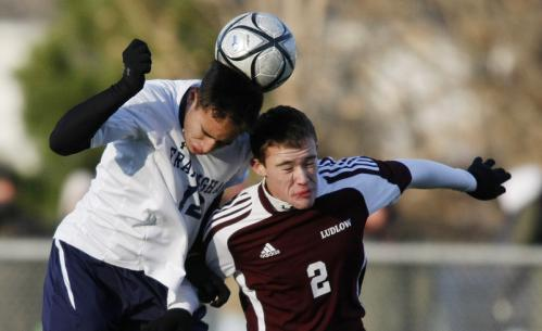 Framingham's Matheus Goncalves heads the ball over Ludlow's Jake Flynn (2).