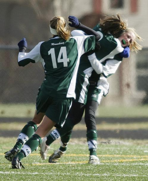 (Left to right): Minnechaug's Marquet Mensing, Sarah Brochu, and Lauren MacLellan celebrate a goal against Acton-Boxboro.
