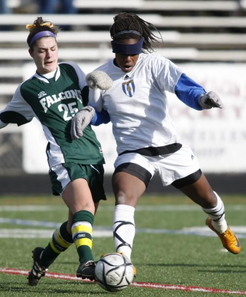 Minnechaug's Kelsey Varzeas (25) battle s for the ball against Acton-Boxboro's Hayley Brock.