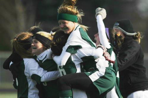 Minnechaug players celebrate their win over Acton-Boxboro.