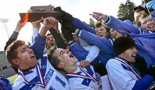 Bromfield School boys' soccer team celebrates its win over Hamilton-Wenham.