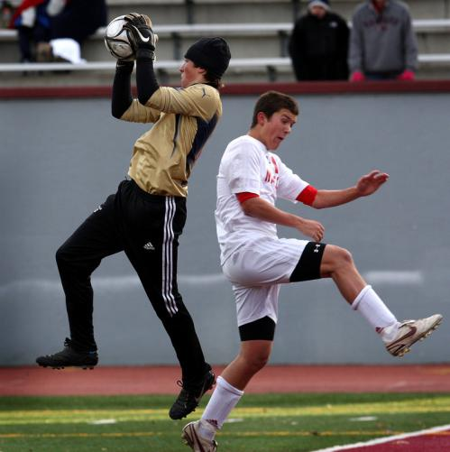 Mt. Greylock goalie Than Finan (left) beat Masconomet's Andrew Panella to the ball.