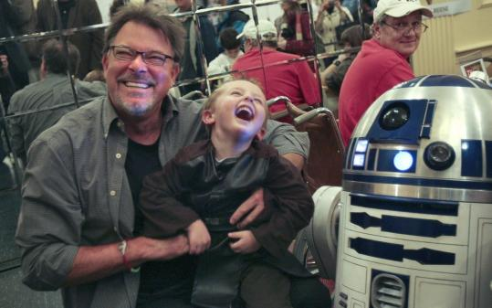 Jonathan Frakes (left) poses with Jesse Powers, 3, and a Star Wars toy at the Super Megafest.