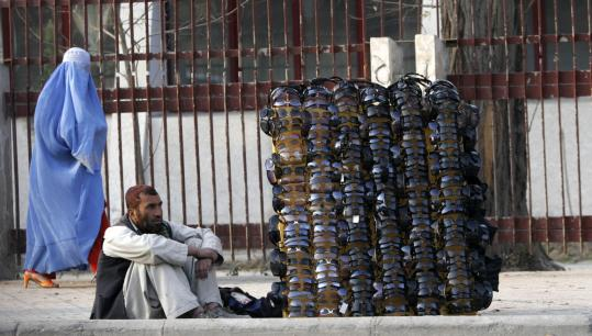A street vendor waits for customers in Kabul, Afghanistan, where terrorism continues to run rampant in the region.