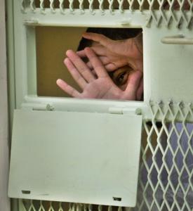 A Guantanamo detainee peered from inside his cell at the US Naval Base at Guantanamo Bay, Cuba.