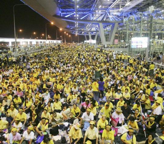 Antigovernment protesters sat at Suvarnabhumi airport in Bangkok yesterday.