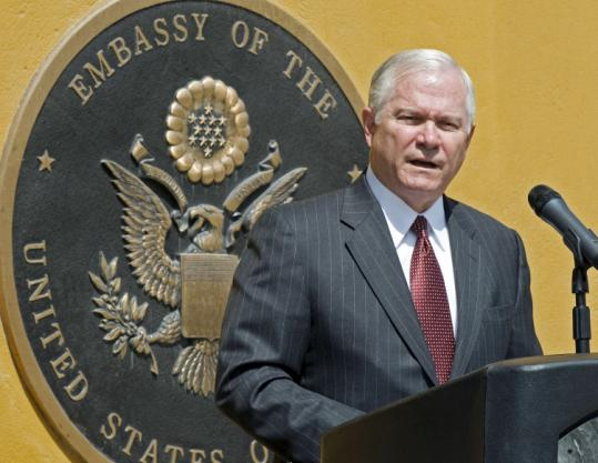 Retaining Defense Secretary Robert Gates, shown in Afghan- istan in September, would provide continuity during the wars.