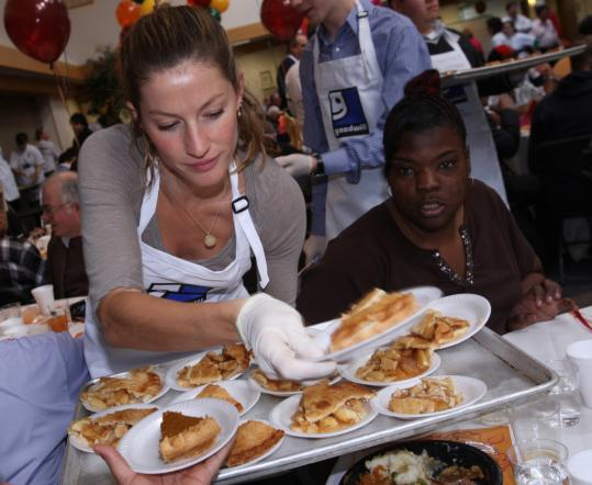 Gisele Bundchen showed up unannounced to help serve at the annual Thanksgiving meal at Goodwill headquarters. Tom Brady joined her later in the day.