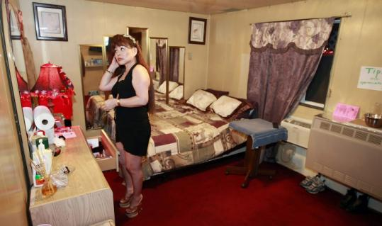 Amy, 58, in her room at Donna's Ranch in Wells, Nev., once bought a $32,000 car in cash; now her mortgage saps her pay.