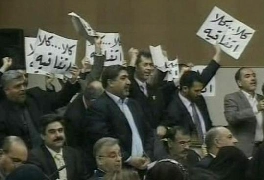 Sadrist lawmakers with placards that read ''No, no to the agreement'' reacted in Iraq's Parliament in Baghdad, after lawmakers approved a security pact with the United States that allows American troops to stay in the country for three more years.