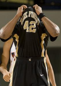 He can't run, but he can hide. Wake Forest's L.D. Williams covers his head after committing a foul in the second half.