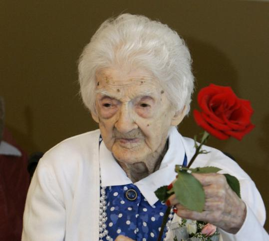 Edna Parker, holding a rose that she was given during a party for her 115th birthday in April.