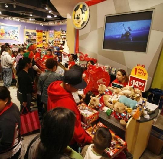 Shoppers line up at a Disney Store in Glendale, Calif. Consumer fears of a deep recession may have kept sales down.