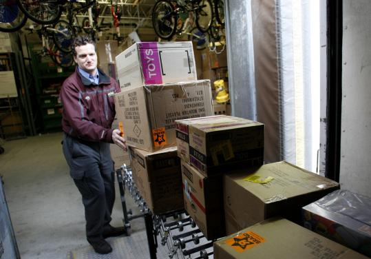 Mark DeMichaelis, founder of the Olivia's Organics Charitable Foundation, with some of the $75,000 worth of toys purchased by his organization at Toys 'R' Us in Framingham last year.