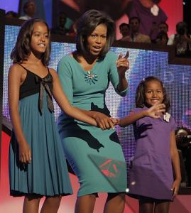 Michelle Obama says she'll be taking time from work to care for her children, Malia, 10, and Sasha, 7.
