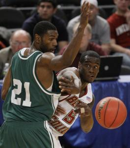 BC guard Biko Paris passes the ball around UAB's Lawrence Kinnard in the consolation game of the NIT Season Tip-Off.