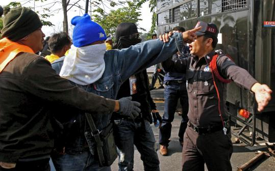 Government protesters confronted police yesterday during the fifth day of the protesters' blockade of Suvarnabhumi International Airport in Bangkok.