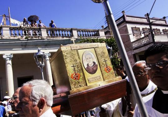 Sven Creutzmann/Mambo photo/Getty ImagesThe remains of Friar Jose Olallo Valdes were carried through Camaguey, Cuba, yesterday after his beatification. It was the first such ceremony on Cuban soil. The monk is credited with the miraculous recovery of a girl with an abdominal tumor in 1999.